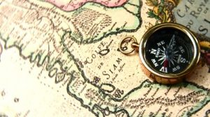 stock-footage-old-brass-compass-over-antique-map-spinning-around